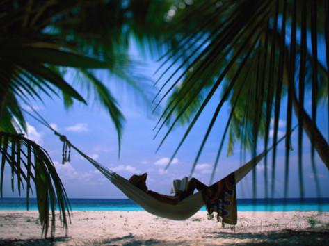 stuart-westmorland-woman-in-hammock-on-beach-ari-atoll-maldives.jpg